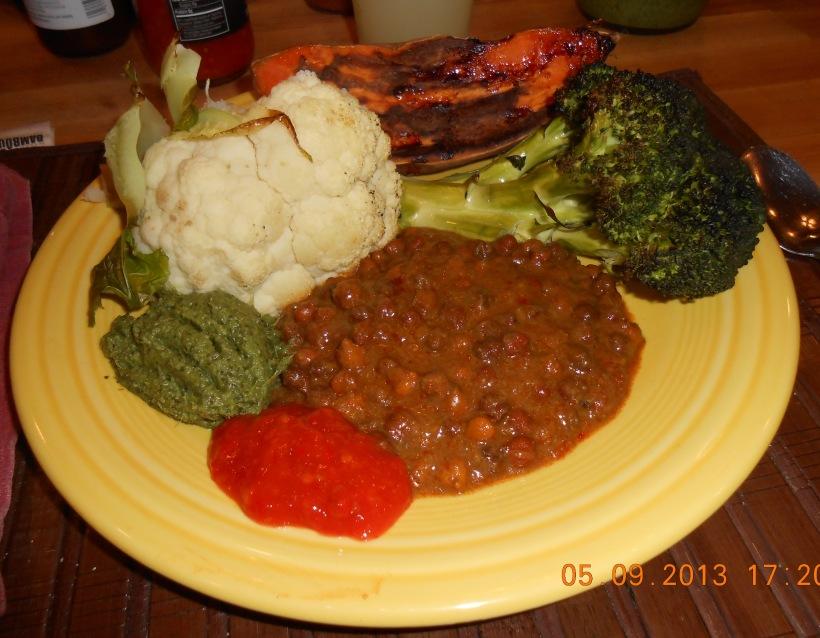 Roasted Cauliflower, Sweet Potato, and Broccoli, Coriander Chutney, Matouks Flambeau Hot Sauce and  Lentils in a spicy tomato Sauce...