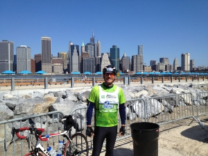 At the Brooklyn BRidge Rest Area with Lower Manhattan as a backdrop.  You can see the New World Trade Center Tower behind me.