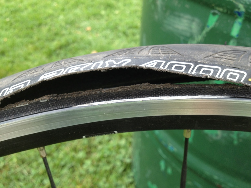 Death of a Tire and a Wheel. The tire had 38 miles on it when it was dealt a dastardly death