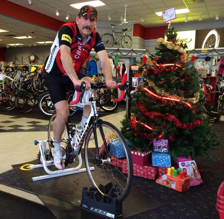 Pedaling my heart out for Toys for Tots.  You can see the toys people have donated sitting around the tree...